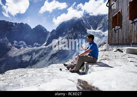 Bouteille d'eau potable de randonneur, Mont Cervin, Matterhorn, Valais, Suisse Photo Stock