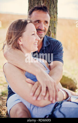 Couple embracing outdoors Photo Stock