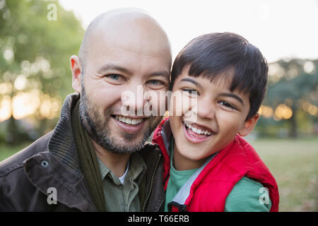 Portrait of happy father and son in park Photo Stock