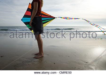 Fille de la mer avec kite Photo Stock