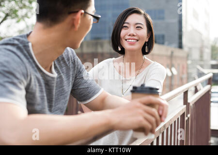 Cheerful young couple talking outdoors Photo Stock