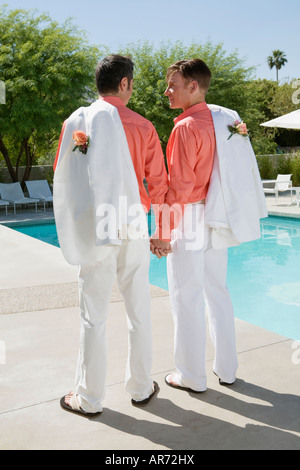 Young gay couple holding hands Photo Stock