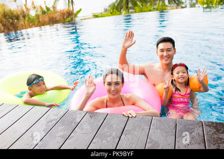 Happy young couple in swimming pool Photo Stock
