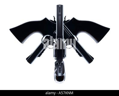 Trois pistolets placés de manière créative pour créer un visage ou de forme intéressante Photo Stock