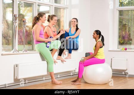Young woman in yoga studio Photo Stock