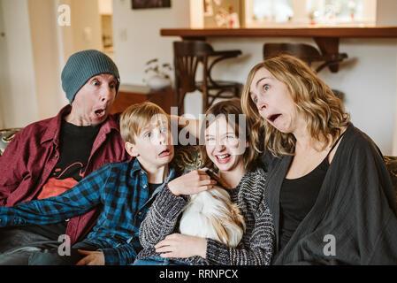 Espiègle, silly family making faces Photo Stock
