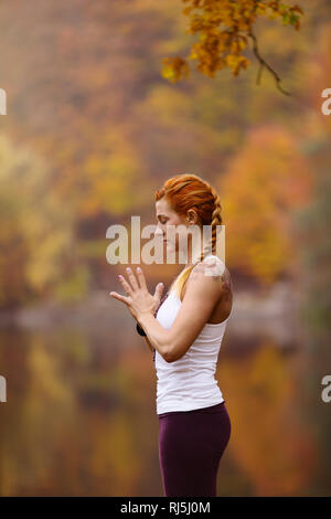 Young woman meditating Photo Stock