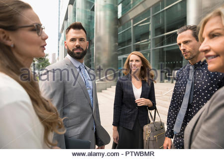 Business people talking on urban sidewalk Photo Stock
