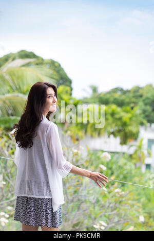 Happy young woman on vacation Photo Stock