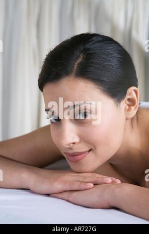 Woman lying on massage table Photo Stock