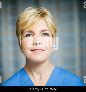 Portrait of doctor in scrubs Photo Stock