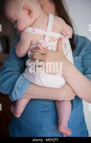 Caucasian mother holding baby daughter Photo Stock
