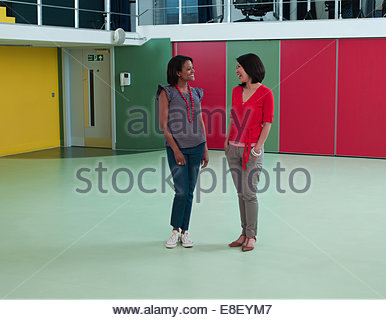 Smiling Businesswomen in empty office Photo Stock