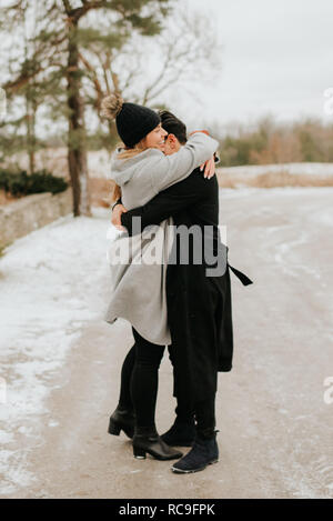 Couple hugging in snowy landscape, Georgetown, Canada Photo Stock