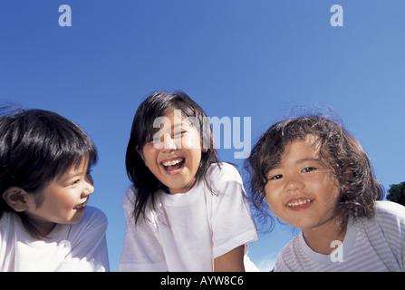 Visages de trois filles Photo Stock