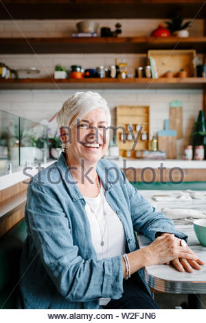 Portrait of happy woman in cafe Photo Stock