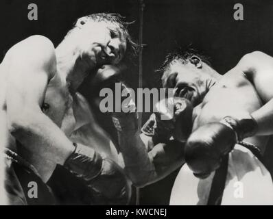 Kid Gavilan (droite) et Billy Graham, dans le 6e round au Madison Square Garden. Le 13 févr., 1950. Les boxeurs Photo Stock