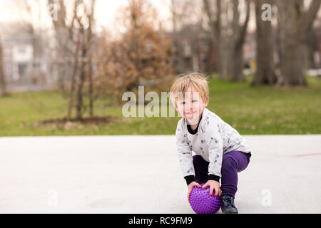 Boy playing ball in park Photo Stock