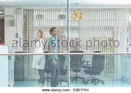 Man and Woman standing at window Photo Stock