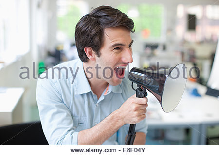 Businessman using megaphone Photo Stock
