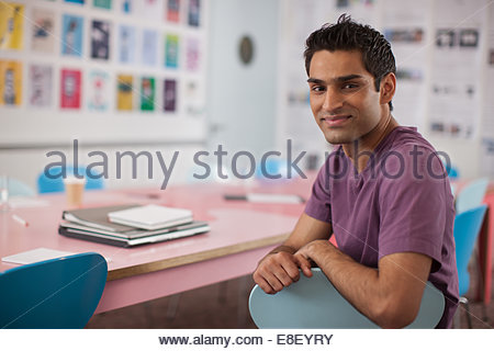 Smiling businessman in office Photo Stock