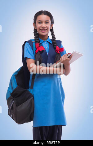 Girl writing notes in classroom Photo Stock