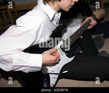 Playing electric guitar Photo Stock