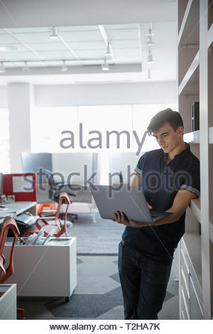 Businessman using laptop in office Photo Stock