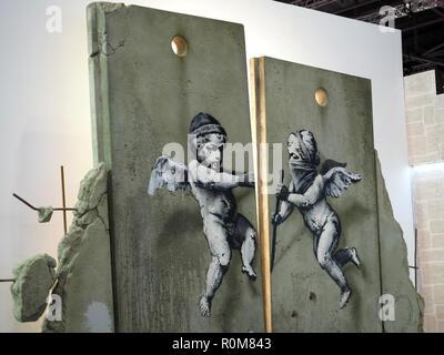 Excel, London, Regno Unito. 5 novembre 2018. Replica di Banksy illustrazione sulla Palestina stand al World Travel Market, Excel, London, oggi (Mon) Credito: Finnbarr Webster/Alamy Live News Immagini Stock