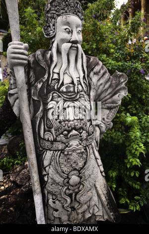 Thailandia, Bangkok, Grand Palace e il Wat Phra Kaeo, pietra custode statua Immagini Stock