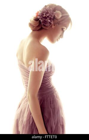 Bella giovane donna con fiori Immagini Stock