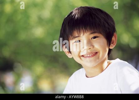 La faccia del ragazzo sorridente Immagini Stock