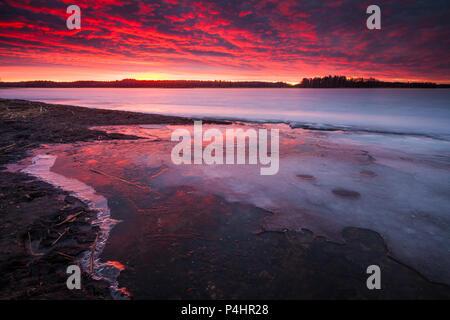 Inverno sunrise nel lago Vansjø, Østfold, Norvegia. Immagini Stock