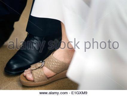 Scarpe di Western e imprenditori arabi Immagini Stock