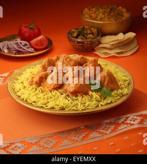 Burro indiano curry di Pollo & Riso Basmati Immagini Stock
