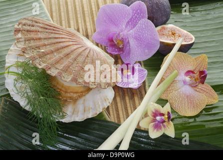 Frutti di mare e fiori di orchidea Immagini Stock