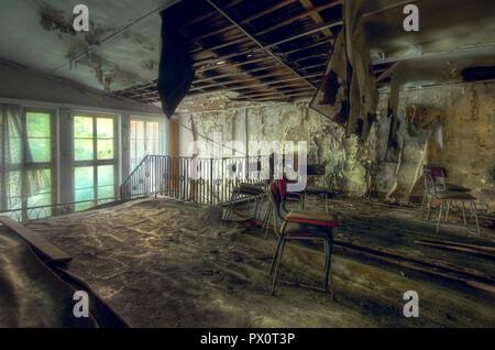 Vista interna di un teatro abbandonato in Germania. Immagini Stock