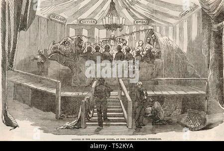 BEJAMIN WATERHOUSE HAWKINS (1807-1894), scultore inglese che ha ospitato una cena di gala il 31 dicembre 1853 all'interno dello stampo ha utilizzato per realizzare un modello di Iguanodon al Crystal Palace. Immagini Stock