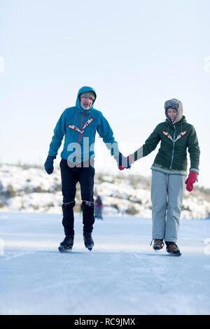 Giovane del pattinaggio su ghiaccio Immagini Stock
