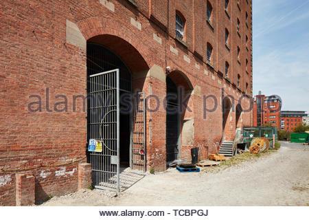 Ingresso del sito. Magazzino di Londra, Manchester, Regno Unito. Architetto: Archer Humphreys architetti, 2018. Immagini Stock