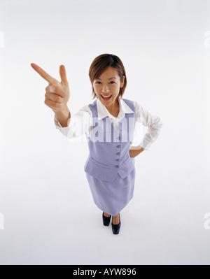 Ufficio di giovane donna in sfondo bianco Immagini Stock