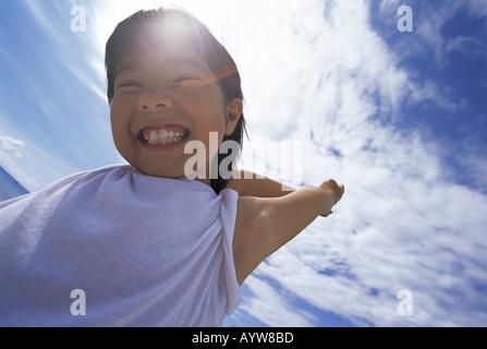 La faccia di una ragazza sorridente Immagini Stock