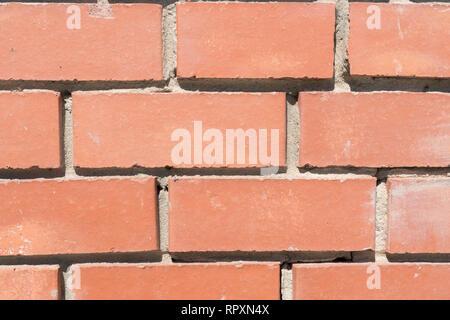 Un muro di mattoni. Tessiturali sfondo Immagini Stock