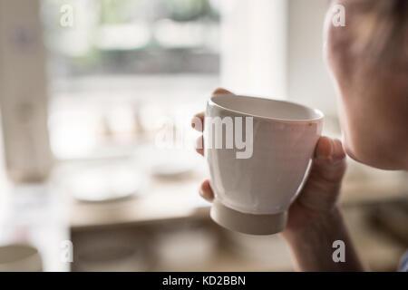 Potter coppa di ritegno Immagini Stock
