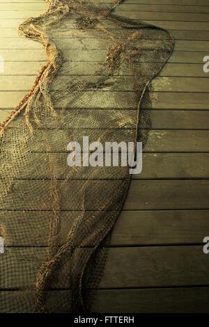 Rete di pesce sulla tavola di legno a piedi Immagini Stock
