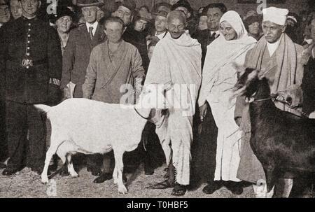 Il Mahatma Gandhi con Madeleine Slade arriva a Londra in Inghilterra nel 1931 Immagini Stock