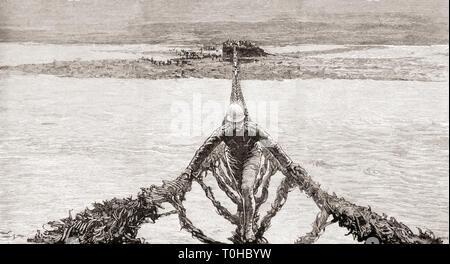 L'uomo attraversando il fiume Gilgit, India settentrionale Immagini Stock