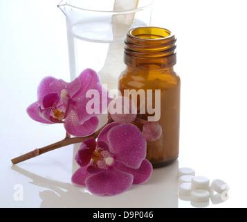 I sali di tessuto e fiori di orchidea Immagini Stock