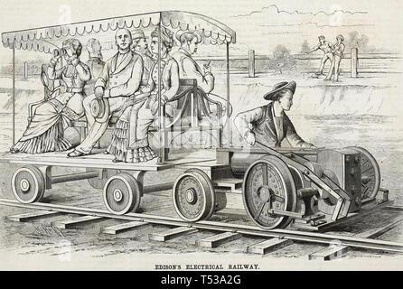 THOMAS EDISON (18457-1931) inventore americano in prova treno elettrico al suo Menlo Park centro di ricerca Immagini Stock